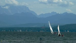 Alpine view on Lake Ammersee with sailboats over Diessen to Zugspitze 16:9