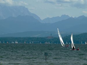 Alpine view on Lake Ammersee with sailboats over Diessen to Zugspitze 4:3