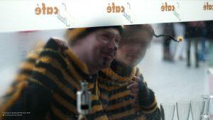 Carnival Bees peeking into Stadtcafe, Munich 16:9