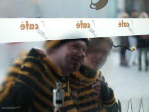 Carnival Bees peeking into Stadtcafe, Munich 4:3