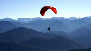 Hang-glider in front of alpine panorama 16:9