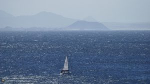 Sailboat cruising at Fuerte Ventura 16:9