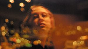 Young woman bathing in city lights 16:9